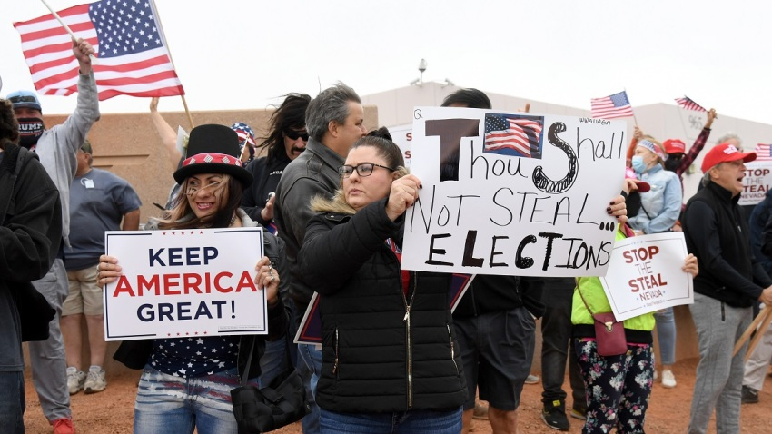 Supporters of President Donald Trump protest outside the Clark County Election Department