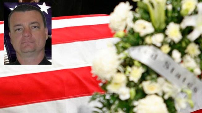 Lágrimas y resignación en funeral de agente